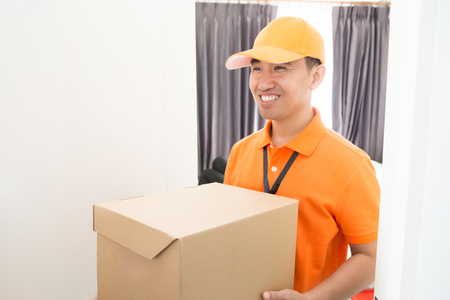 Delivery Man Shipping The Box To Client